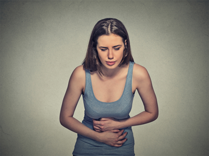 Girl clutching stomach